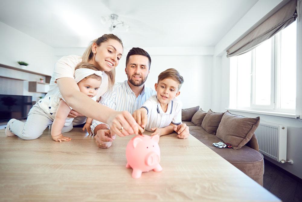 Family gathered around piggy bank